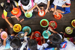 Children having lunch in asian school Stock Image