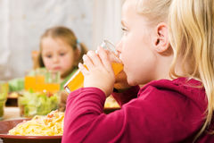 Children having noodles Royalty Free Stock Photo