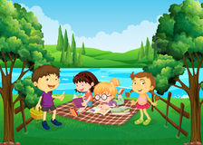Children having picnic by the river Royalty Free Stock Images