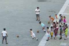 Children having sports lesson Havana Royalty Free Stock Images