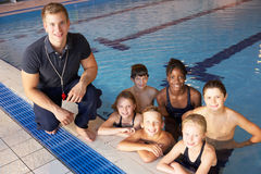 Children having swimming lesson Stock Photos