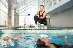 Children Having Swimming Lesson royalty free stock images