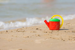 Children head left on shore of the beach near the water Royalty Free Stock Photography