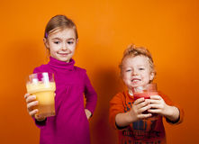 Children with healthy juice drinks Royalty Free Stock Photo
