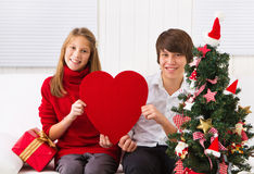 Children with heart on Christmas Stock Photo