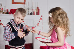 Children With Heart-shaped Cakes Stock Photo
