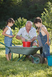 Children is helping her Grandfather in the garden Royalty Free Stock Photos