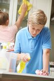Children Helping With Household Chores And Cleaning Kitchen Stock Photography