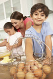 Children Helping Mother To Bake Cakes In Kitchen Royalty Free Stock Image