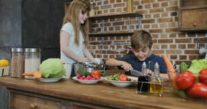 Children Helping Parents With Cooking Cutting Vegetables, Happy Family Preparing Food Together In Kitchen stock footage