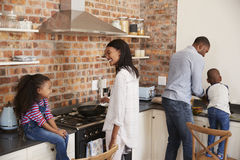 Children Helping Parents To Prepare Meal In Kitchen Stock Photography