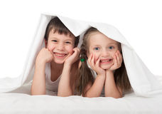 Children hiding under the blanket Stock Photography