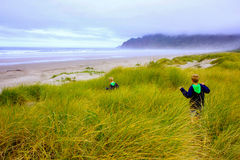 Children Hike Tall Grass to Beach royalty free stock photos
