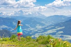 Children hiking in Alps mountains. Kids outdoor. Children hiking in Alps mountains. Kids look at snow covered mountain in Austria. Spring family vacation Royalty Free Stock Photos