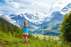 Children hiking in Alps mountains. Kids outdoor. royalty free stock photos