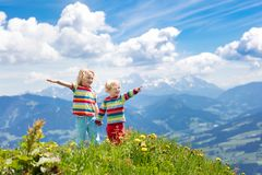 Children hiking in Alps mountains. Kids outdoor stock photography