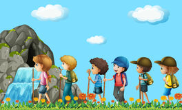 Children hiking in the field Stock Photos