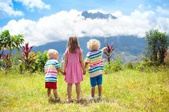 Children hiking in mountains and jungle. Royalty Free Stock Photography