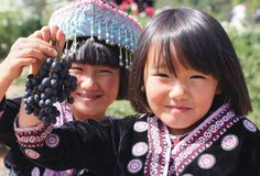 Children hill tribe. Hill tribe child so happy to have a grape Royalty Free Stock Images