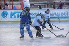 Children with hockey sticks playing hockey at the festival royalty free stock photo