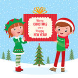 Children hold a big Christmas gift Stock Image