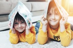 Children hold books over their heads royalty free stock images