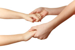 Children hold each other's hands. Close-up. Isolated on white background stock images