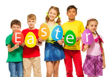 Children hold egg shape colourful cards together Stock Image