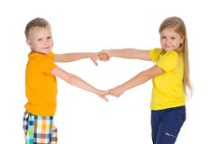 Children hold hands. Two children hold hands against the white background royalty free stock photo