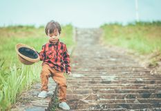 Children hold hat and walking on stair. .A children have mucus royalty free stock photography