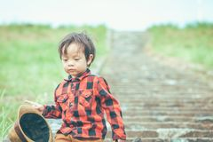 Children hold hat and walking on stair. .A children have mucus royalty free stock photo