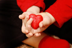 Children hold our hearts in their hands 3 Stock Images
