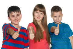 Children hold their thumbs up Royalty Free Stock Image
