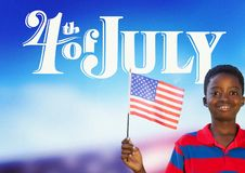 Children holding an american flag for the 4th of July stock photo