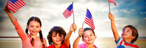 Children holding American flags stock photography