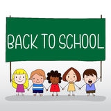 Children holding back to school board Royalty Free Stock Images