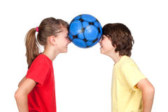 Children holding a ball with their foreheads Royalty Free Stock Photo