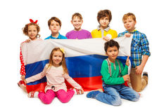Children holding big flag of Russian Federation Stock Image