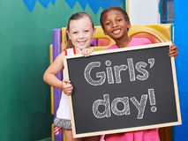 Children holding blackboard for Girls' Day Royalty Free Stock Image