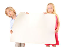 Children holding a blank cardboard paper on white Stock Photo