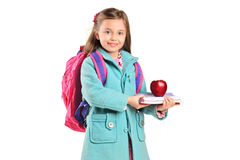 Children holding books and apple Stock Image