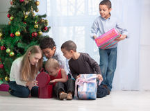 Children holding Christmas gifts Stock Image