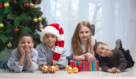 Children holding Christmas gifts Stock Photos