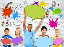 Children Holding Colorful Speech Bubbles Stock Image