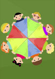Children holding colourful scarf in a circle Royalty Free Stock Photo