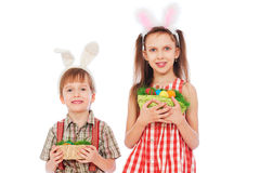 Children holding easter eggs royalty free stock photos