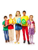Children holding egg shape colourful cards in row Royalty Free Stock Images