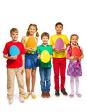 Children holding egg shape colourful cards Stock Photo