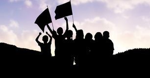 Children holding flags on mountain against sky Stock Images