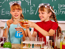 Children holding flask in chemistry class. Stock Photography